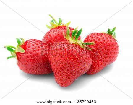 Some red. tasty strawberries with leaves, isolated on a white background.