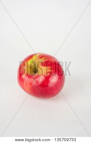 A shiny red apple isolated on a white background