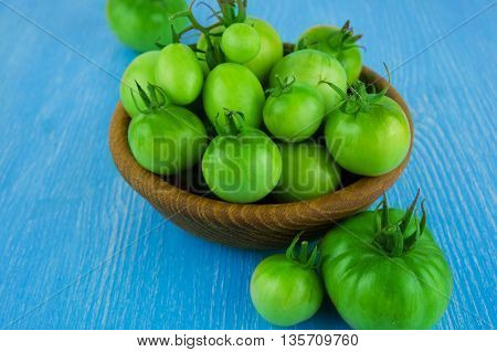 cherry tomatoes isolated in wooden bowl. Fresh organic vegetables.