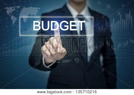 Businessman hand touching BUDGET button on virtual screen