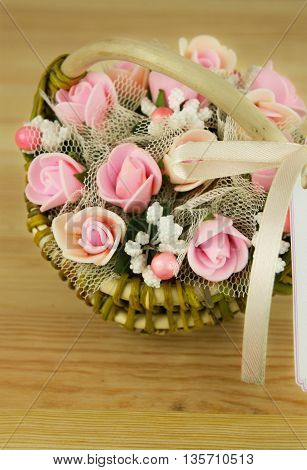 a bouquet of flowers in a basket of handmade