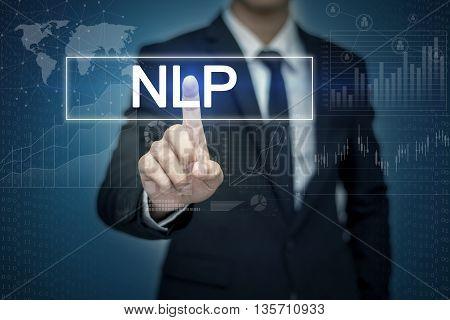 Businessman hand touching NLP button on virtual screen