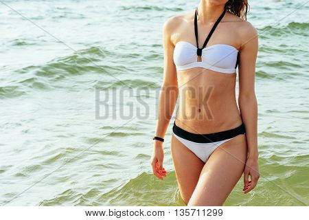 Pretty Slender Girl In Swimsuit Standing In The Sea Water In Sunlight