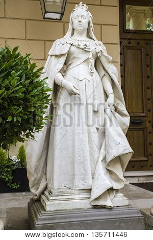 A statue of Queen Victoria situated on Carlton House Terrace in central London.
