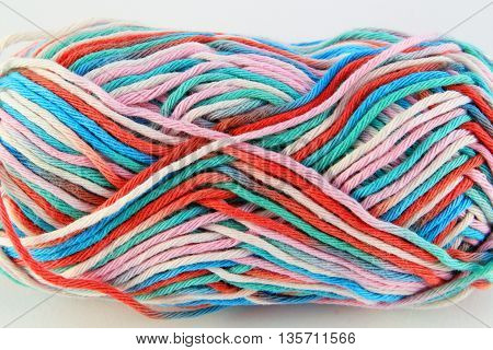bale of wool of different colors with white background