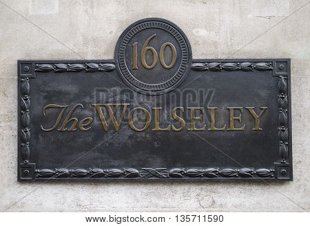 LONDON UK - MAY 7TH 2016: The plaque outside The Wolseley Restaurant on Piccadilly in central London on 7th May 2016.