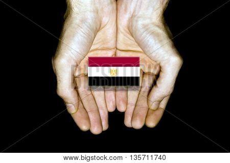 Flag Of Egypt In Hands On Black Background