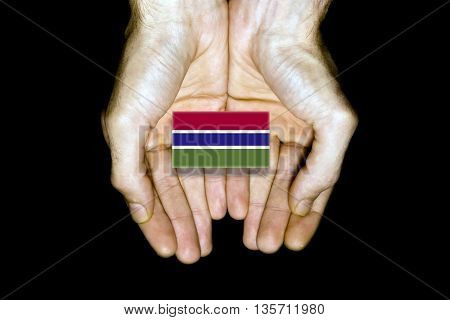 Flag Of Gambia In Hands On Black Background