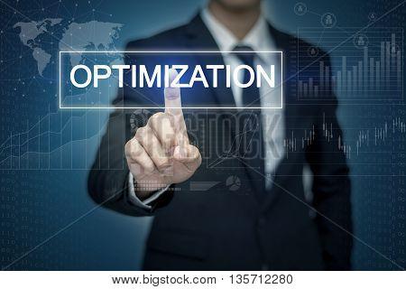 Businessman hand touching OPTIMIZATION button on virtual screen