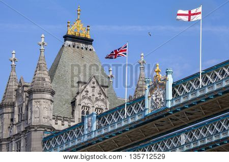 The Union Flag and St Georges Flag proudly flying on the top of Tower Bridge in London.