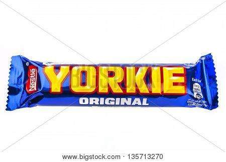 LONDON UK - MAY 6TH 2016: An unopened Yorkie chocolate bar manufactured by Nestle pictured over a plain white background on 6th May 2016.