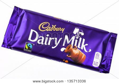 LONDON UK - MAY 6TH 2016: An unopened Dairy Milk chocolate bar manufactured by Cadbury pictured over a plain white background on 6th May 2016.