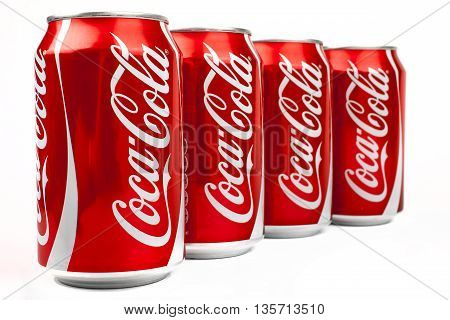 LONDON UK - MAY 6TH 2016: Cans of Coca Cola drink isolated over a plain white background on 6th May 2016. The drink is produced and manufactured by The Coca-Cola Company.