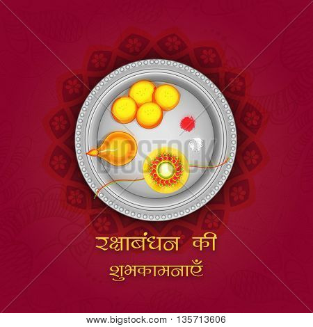 Beautiful decorated Thali (Plate) with Rakhi, Sweet and Earthen Lamp, Elegant Greeting Card design with Hindi Text (Best Wishes of Raksha Bandhan) on floral background.