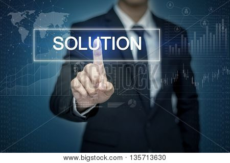 Businessman hand touching SOLUTION button on virtual screen