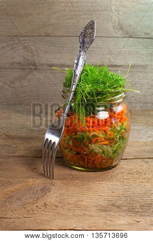 Fresh vegetables prepared for canning. With a fork on a wooden surface