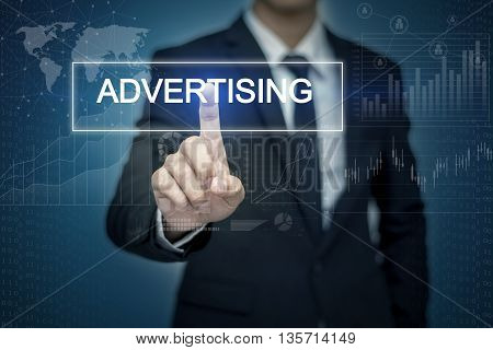 Businessman hand touching ADVERTISING button on virtual screen