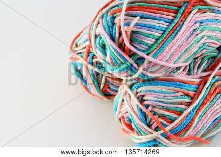 bales of wool in different colors with white background