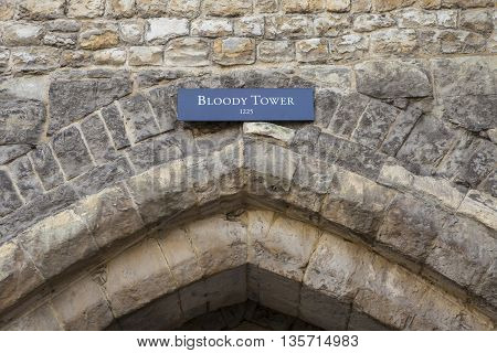 The plaque and main archway to the Bloody Tower at the Tower of London. A total of 12 towers make up the historic Tower of London fortification.
