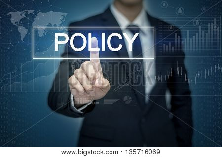 Businessman hand touching POLICY button on virtual screen