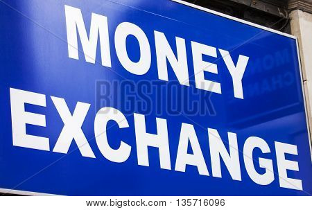 LONDON UK - APRIL 7TH 2016: A close-up of the logo of a Money Exchange outlet on Oxford Street in central London on 7th April 2016.