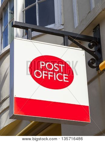 A Post Office sign in an English town.