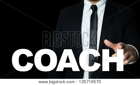 Business man pointing the text: Coach