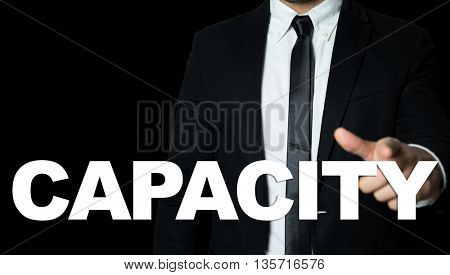 Business man pointing the text: Capacity