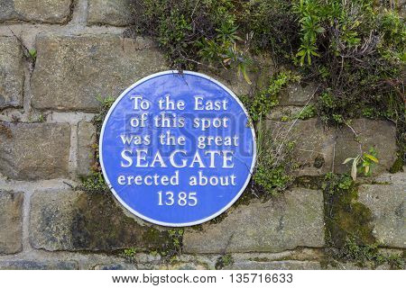 A blue plaque marking the location of the great western Seagate erected in about 1385 to block the old town of Hastings from the sea.