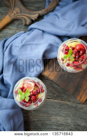 Two glasses with chia seeds pudding on a rustic background
