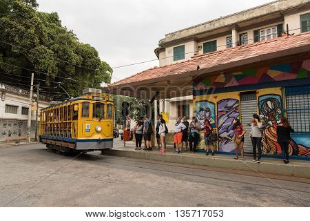 Rio de Janeiro, Brazil - June 18, 2016: New version of the classic yellow tram of Santa Teresa riding in the streets.