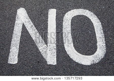The word NO painted on a Road.
