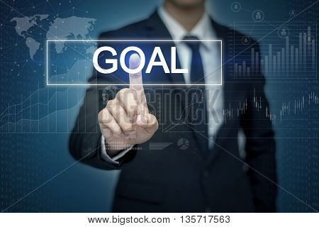 Businessman hand touching GOAL button on virtual screen
