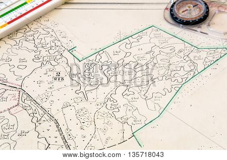 Plan of the land plot with applied objects and tools: compass ruler.