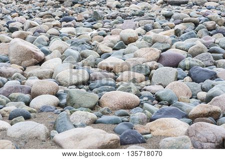 Rocks driven onto beach by winter storms