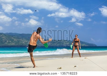 Young active couple having fun on the tropical beach