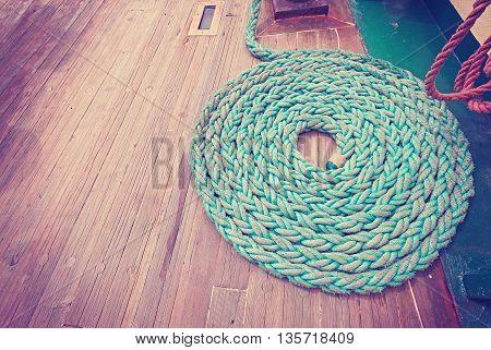 Vintage Toned Mooring Rope On Wooden Deck.