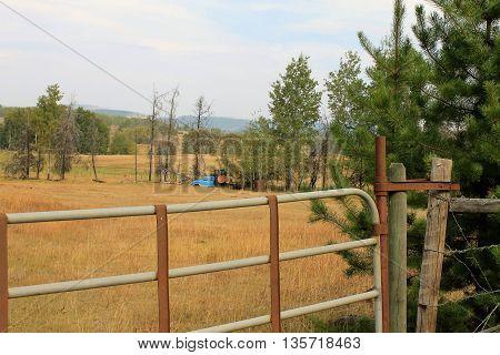 Farm truck as seen though the gate