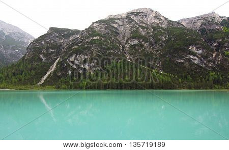 Mountain Lake And Mountain Face In The Alps (dolomites)