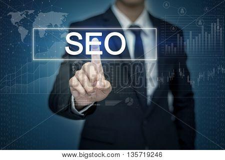 Businessman hand touching SEO button on virtual screen