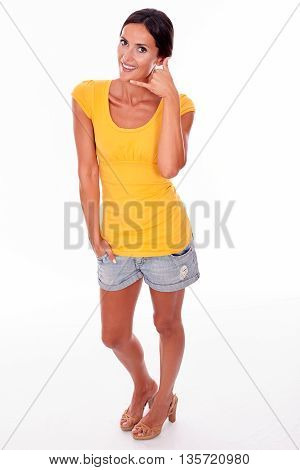 Smiling Brunette Gesturing A Phone Call