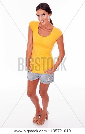 Smiling Brunette With Hands In Pockets