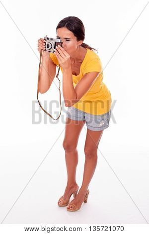 Young Brunette Woman With A Camera
