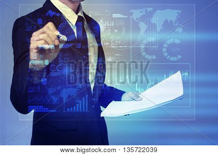 Businessman in blue suit working with digital virtual screen