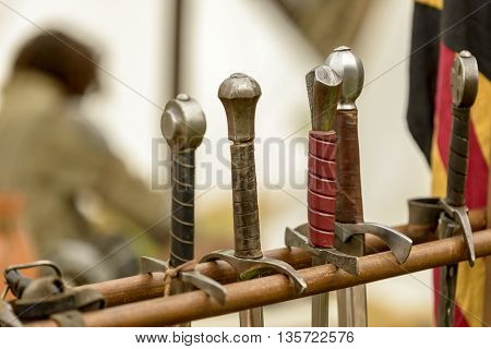 handles of swords to a medieval reenactment