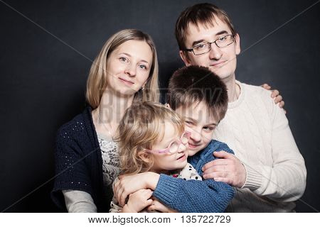 beautiful family together smiling and looking. on dark background