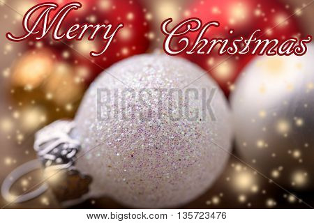 white and red christmas balls with glitter and merry christmas written for christmas background
