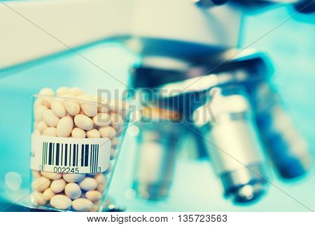 Beans in laboratory microscope background. Toned photo