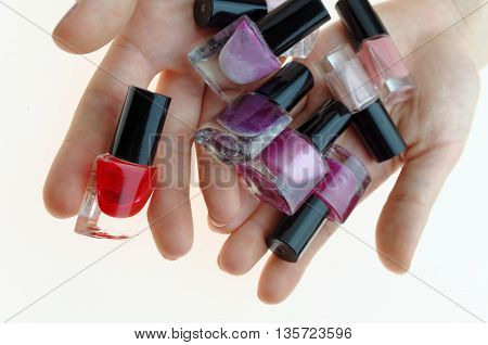 teen applaying nail polish to hands and feet fingers