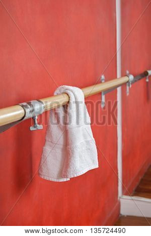 White Napkin Hanging On Bar By Wall